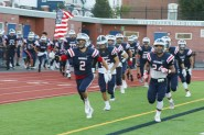 Captains Zack Carifio and Darius McNeil lead the way into Della Russo Stadium for the RHS Patriots last Friday evening.